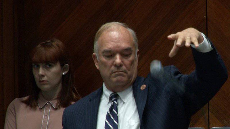 Then-Rep. Don Shooter, R-Yuma, drops the mic after defending himself on the floor of the...