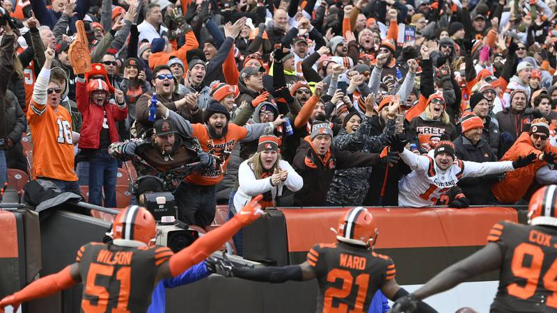 Cleveland Browns cornerback Denzel Ward (21) celebrates his touchdown with fans during an NFL...