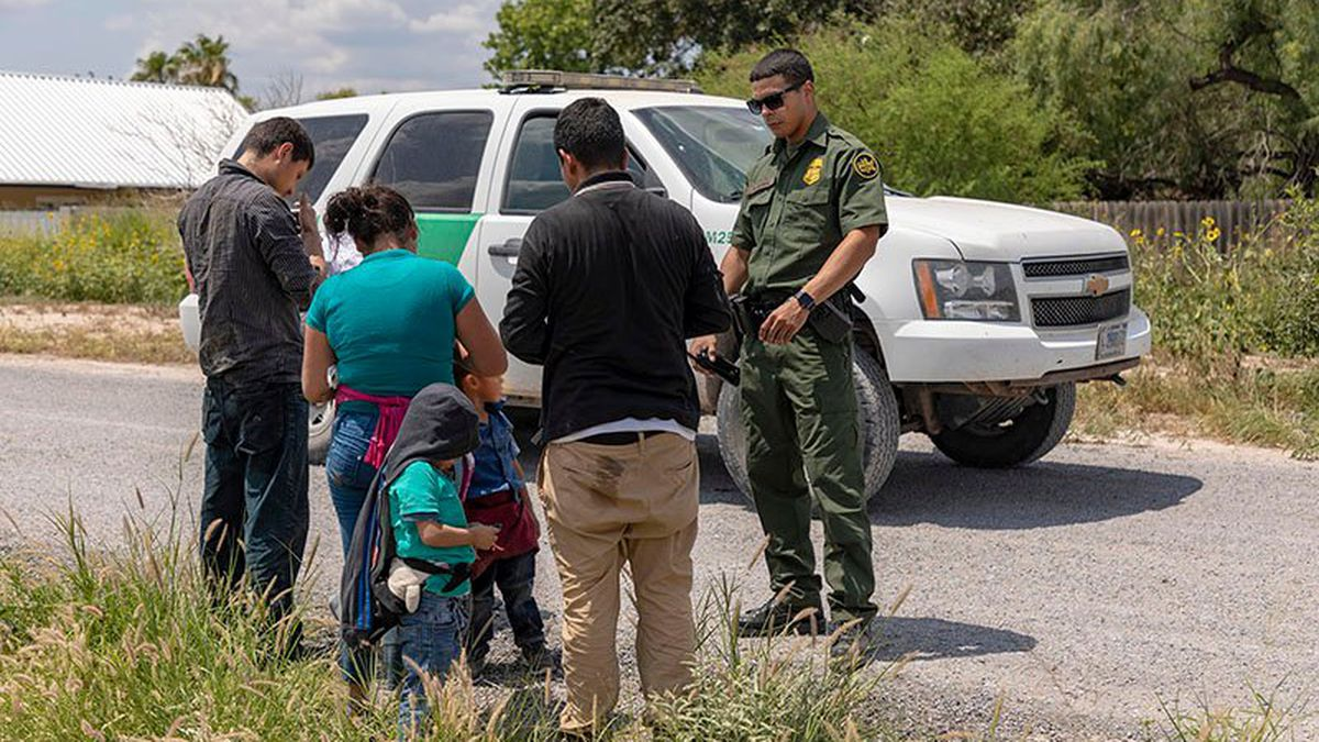 An immigrant family turns itself in to Border Patrol after crossing the Rio Grande in 2019 to...