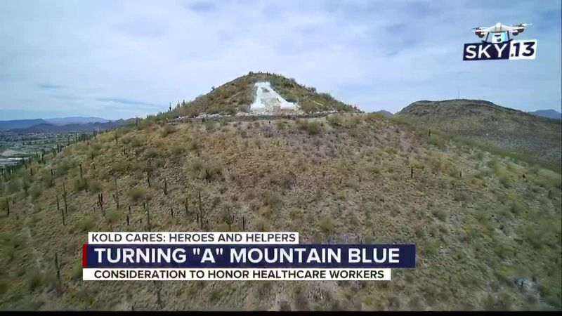 Heroes and Helpers: Turning A Mountain blue