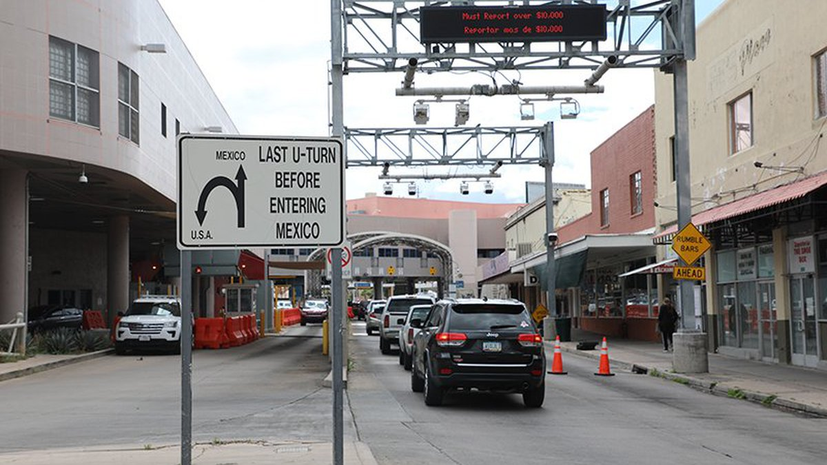 A sign warns drivers of their last opportunity to turn around before crossing the border into...