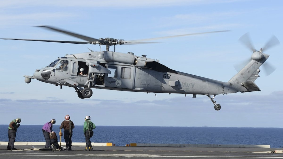 FILE - In this March 19, 2017 photo released by the U.S. Navy, an MH-60S Sea Hawk helicopter...