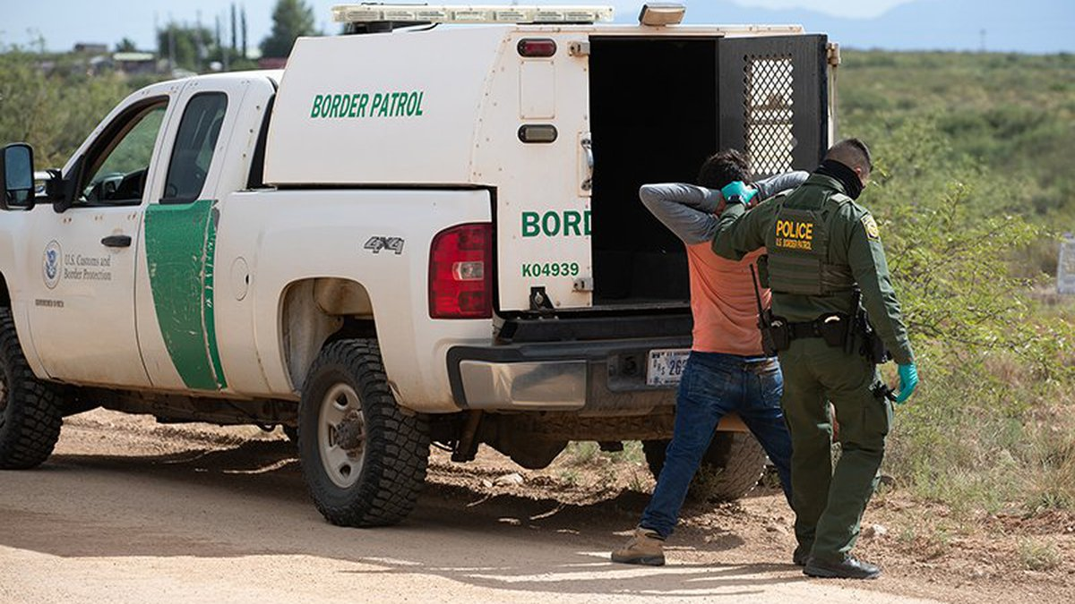 A Border Patrol agent with a migrant who was caught near Naco, Arizona, in August 2020. Customs...