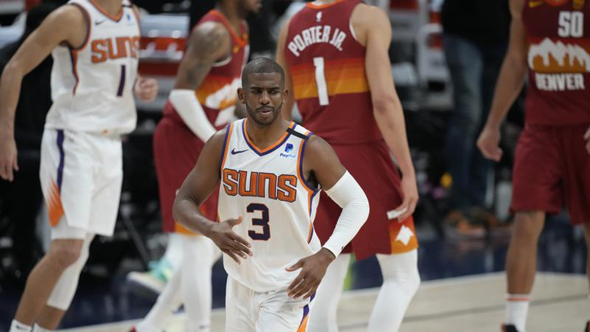 Phoenix Suns guard Chris Paul, front, reacts after hitting a basket late in the second half of...