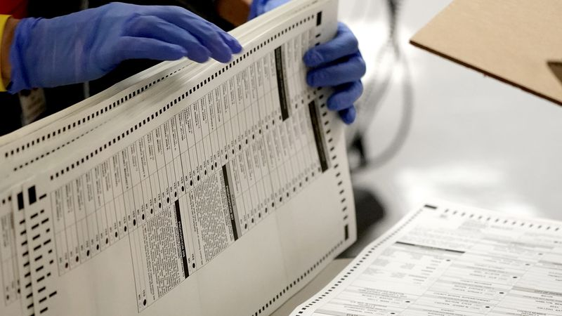 Maricopa County elections officials count ballots, Wednesday, Nov. 4, 2020, at the Maricopa...