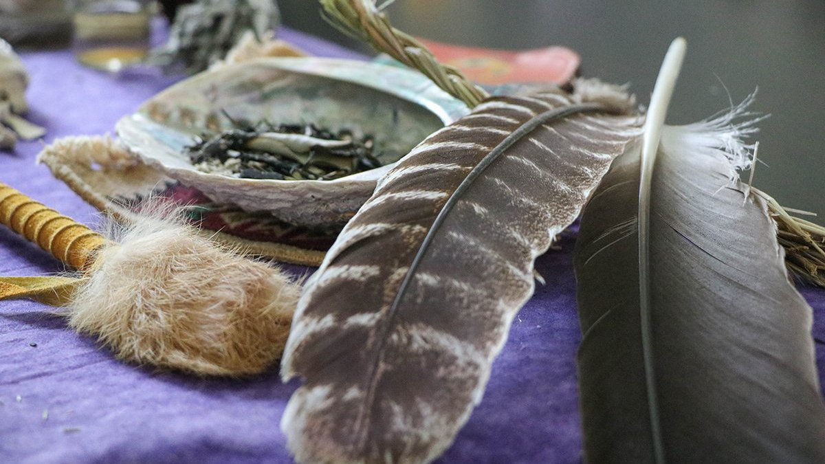 Eagle feathers and dried sage in a seashell are among the sacred items that Andrea Klimas,...