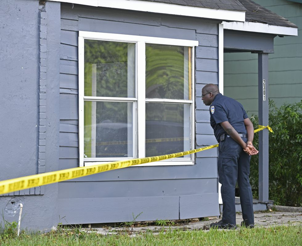Chief Murphy Paul looks into an unoccupied home on scene as Baton Rouge Police investigate a...