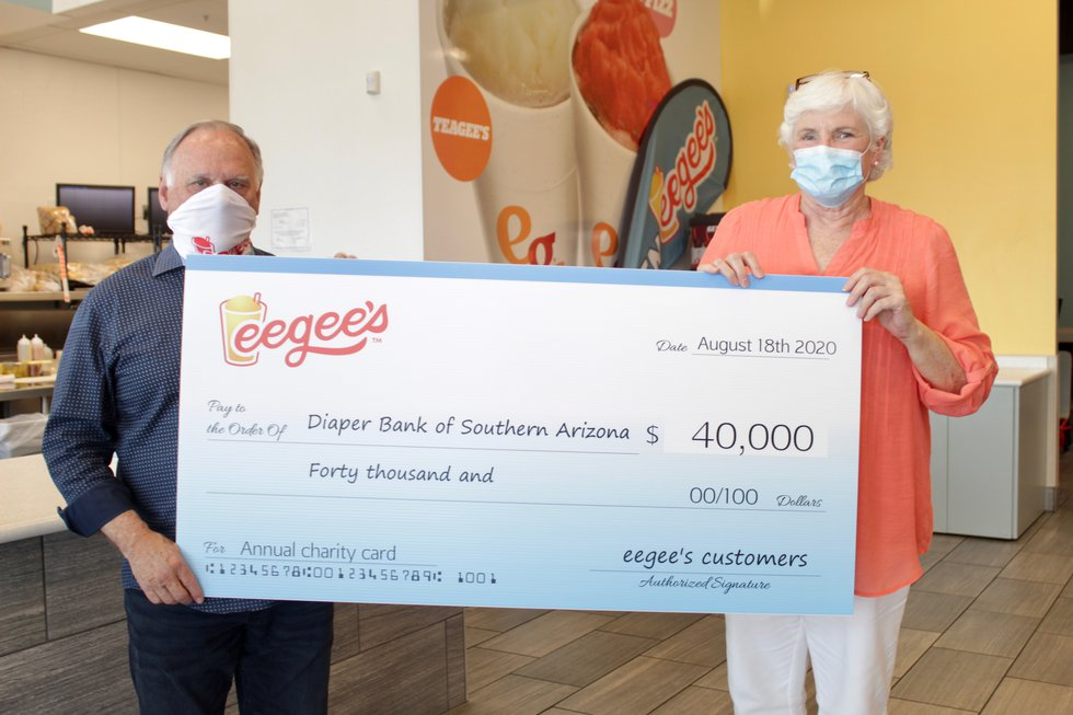 eegee's CEO Ron Petty presents a $40,000 donation to Bonnie Demorotski, President of the Board...