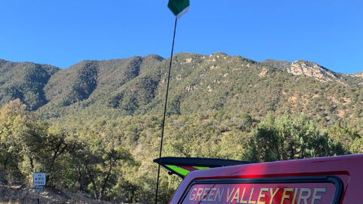 Rescuers from Green Valley and Tubac fire districts help an injured hiker stranded in Madera...
