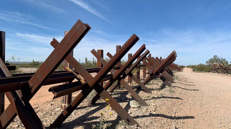 This barrier made of railroad tracks, known as Normandy vehicle barrier, lines the Mexico...