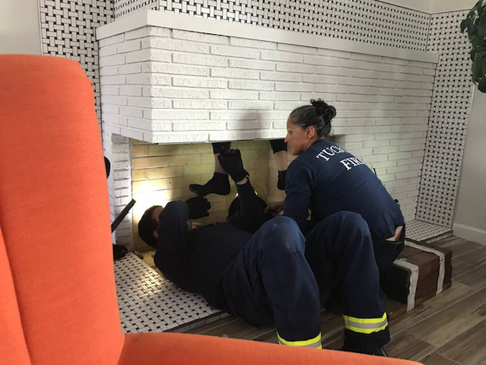 Tucson Fire Department on a rescue call for a man stuck in the chimney.