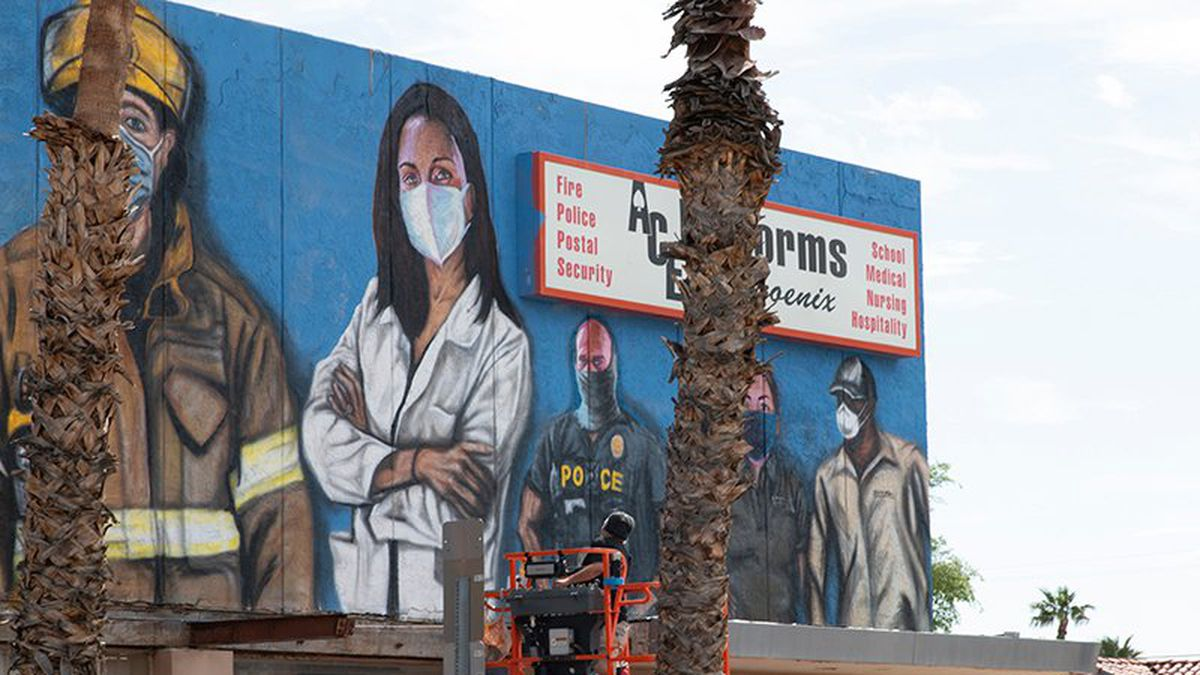 Hugo Medina's first responders mural stresses the importance of wearing a mask.
