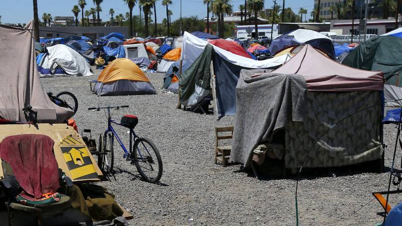 In this Wednesday, Aug. 5, 2020, file photo, a large homeless encampment is shown in Phoenix....