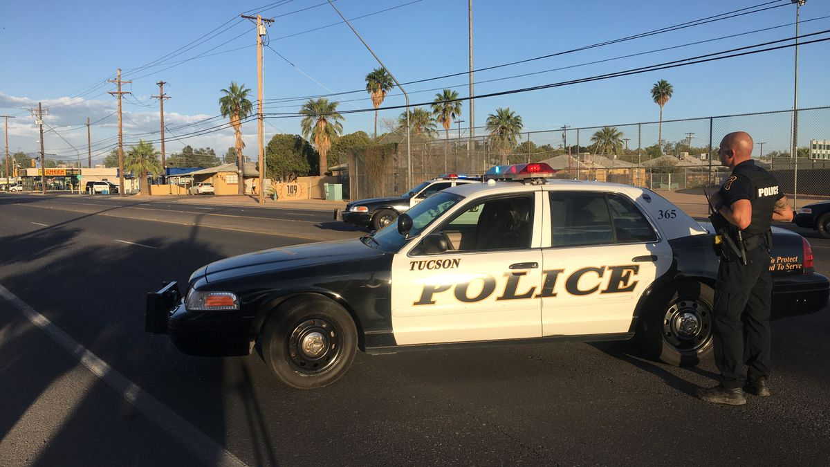 Police say one officer fired after the suspect showed a gun.