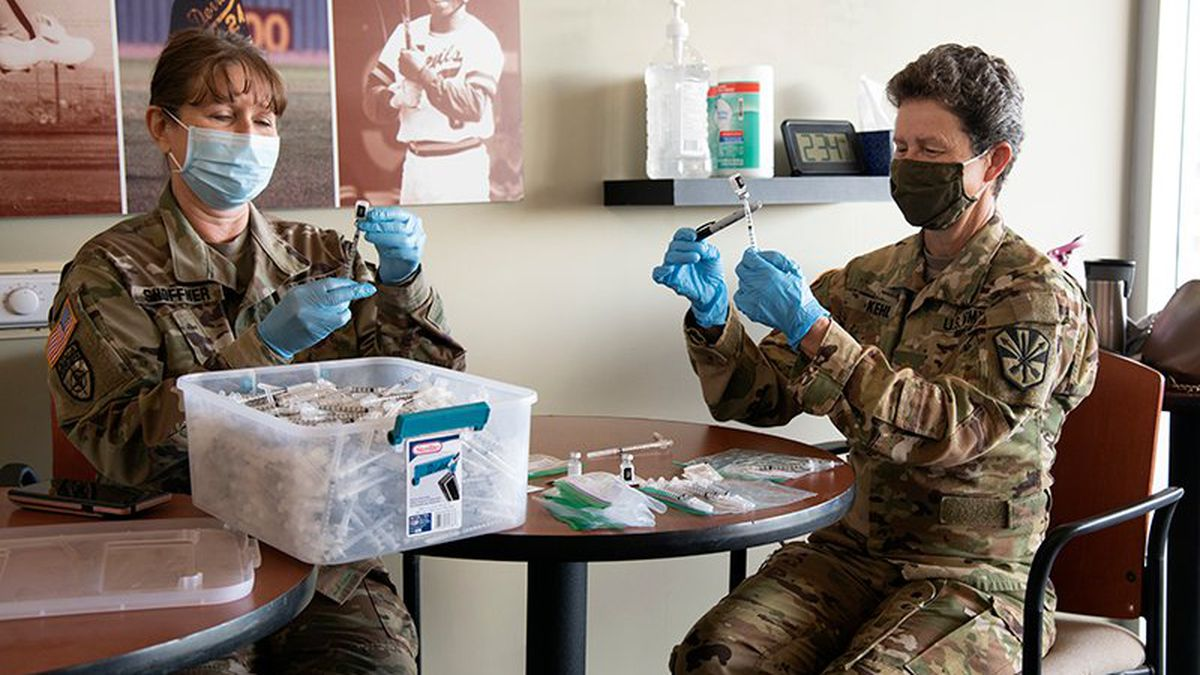 Lt. Col. Joann Shoffner, left, and Maj. Mary Kehl of the Arizona Army National Guard fill...
