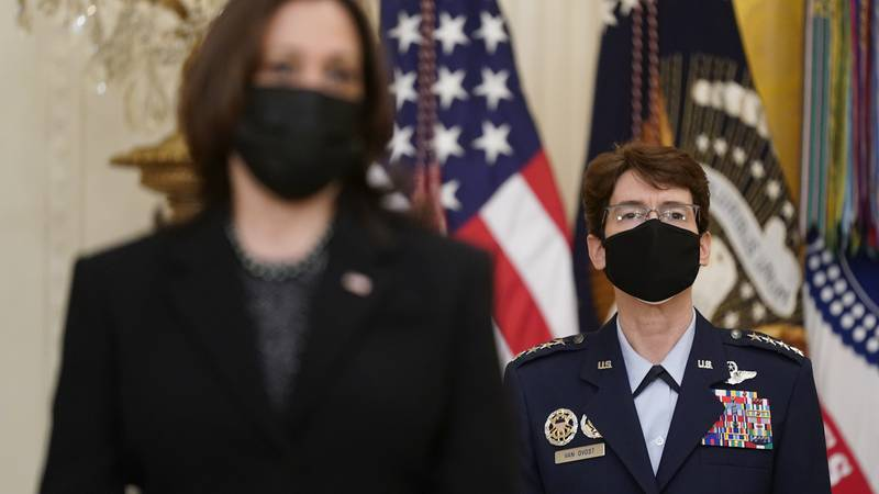 FILE - In this March 8, 2021, file photo, Air Force Gen. Jacqueline Van Ovost, back right,...