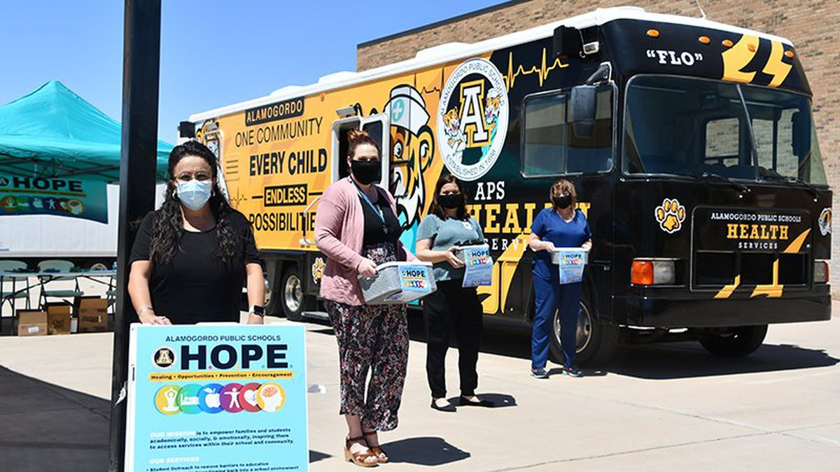 The Alamogordo Public Schools health services team gets ready to hand out snacks and water...