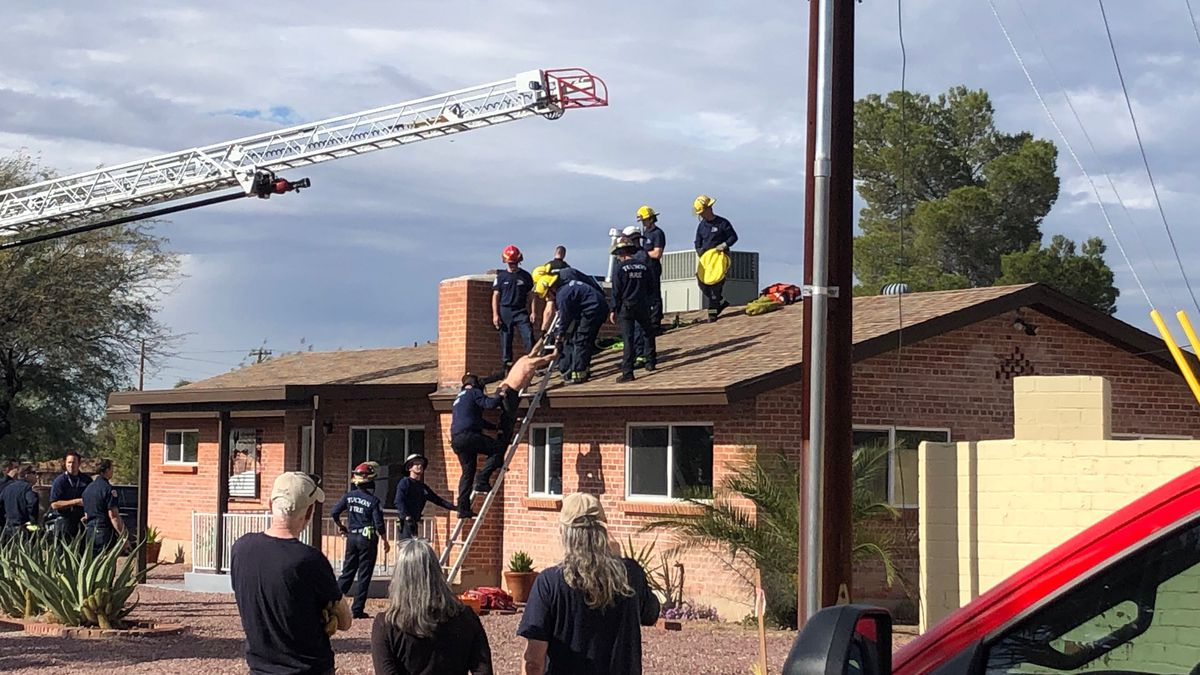 The man was stuck at the bottom of the chimney with his feet sticking out, first responders...