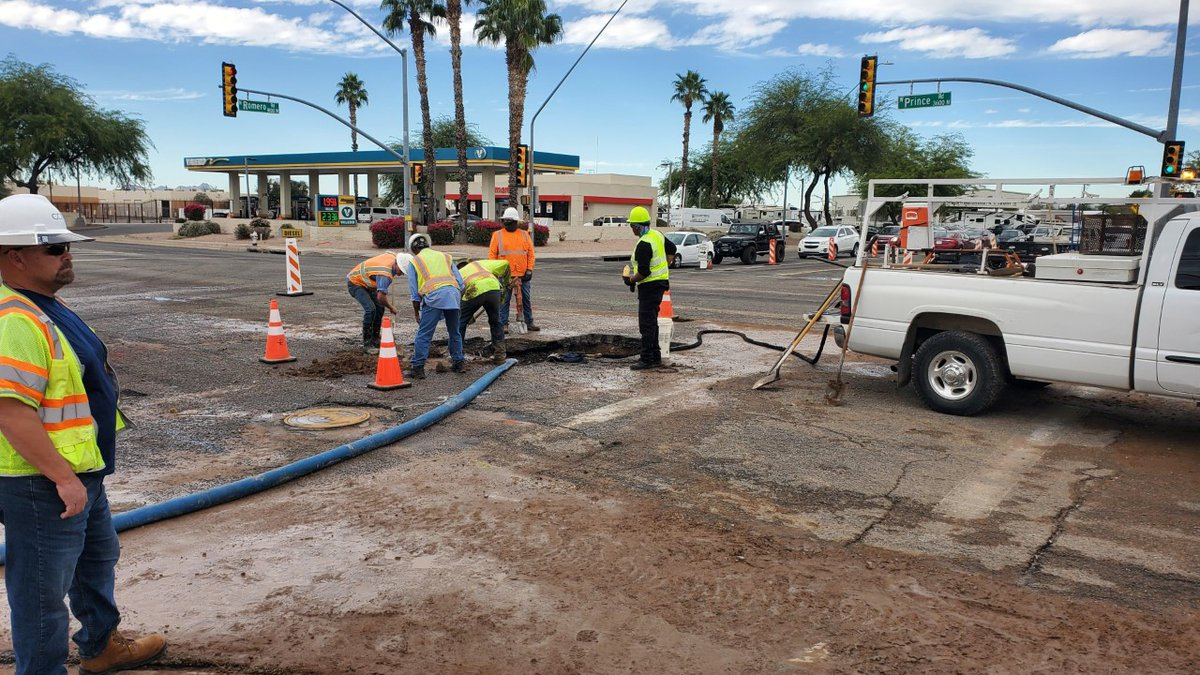 Crews work on a water main break near the intersection of Prince Road and Romero Road in...