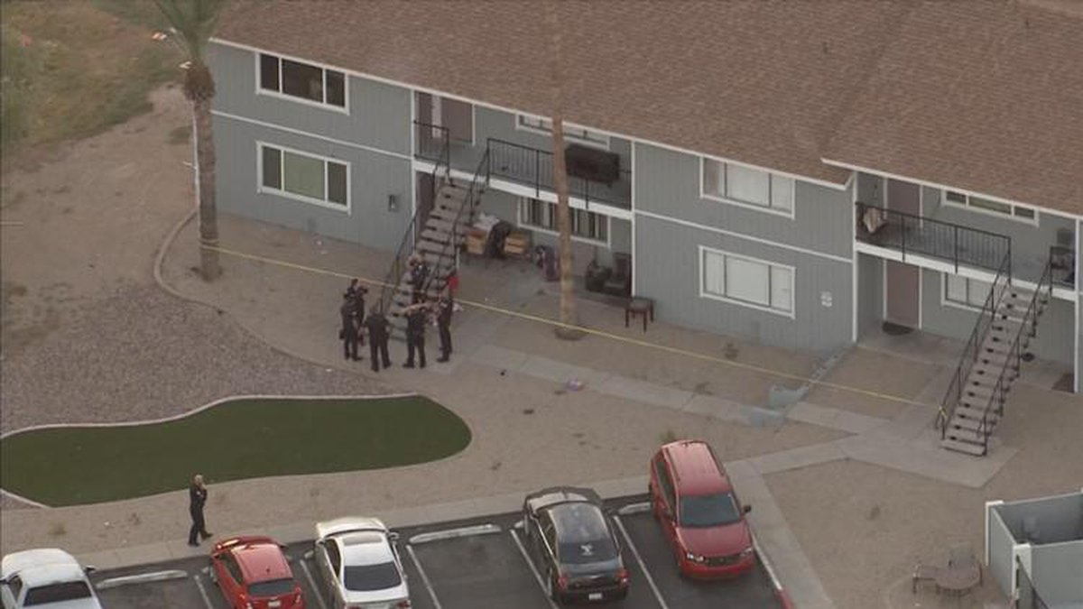 Aerial video shows crime tape around one of the two-story apartment buildings in the complex.