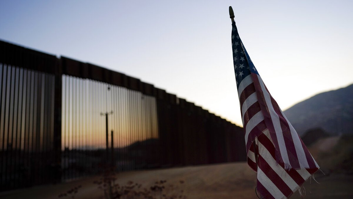 In this Sept. 24, 2020, file photo a flag sits just north of a new section of the border...