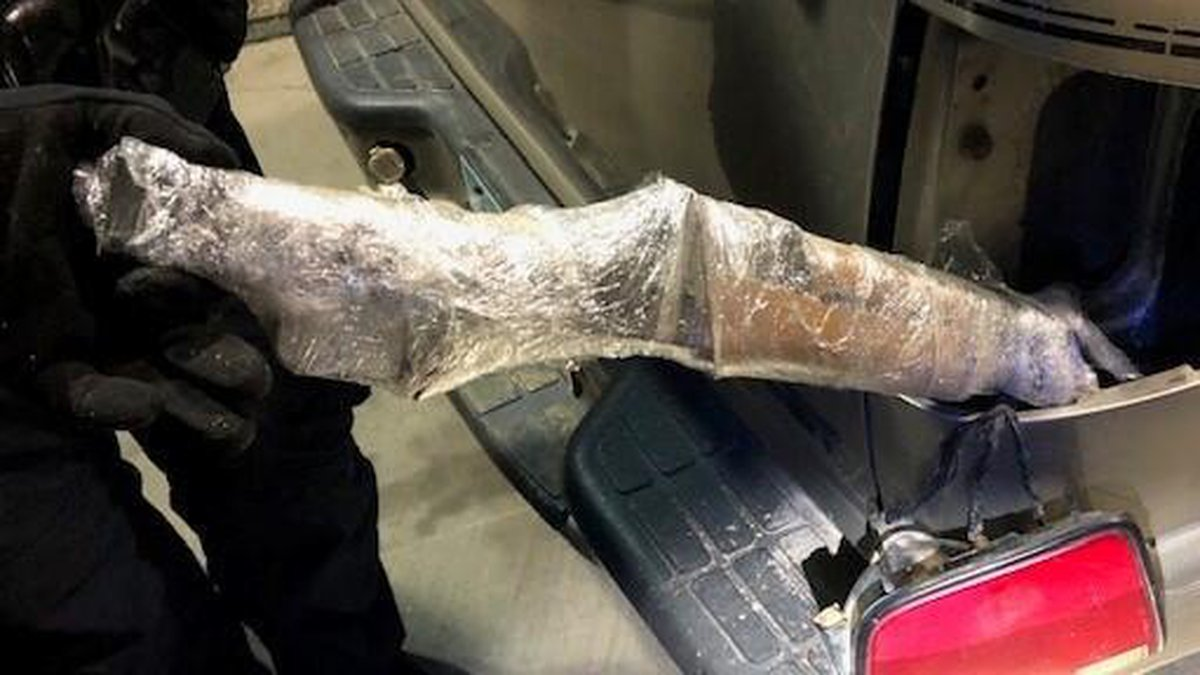 Authorities say they found four assault rifles hidden around a truck headed to Mexico on...