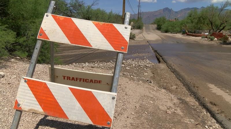Crews work to repair roads, remove sediment and debris