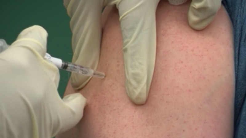 A unidentified person gets a shot of COVID-19 vaccine.
