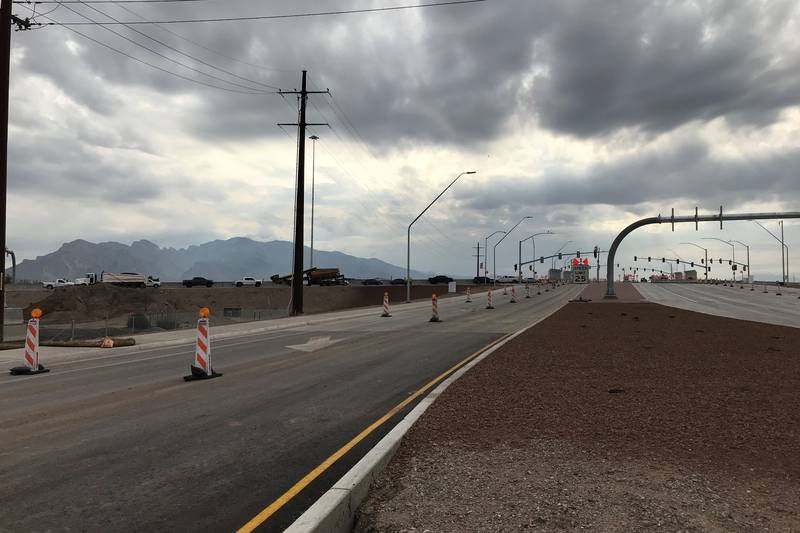 Crews widened Ruthrauff/El Camino del Cerro to two lanes in each direction crossing I-10 and...