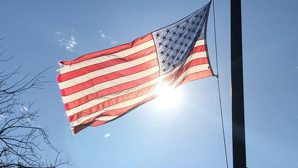 The American flag at half staff outside Tuscaloosa police headquarters