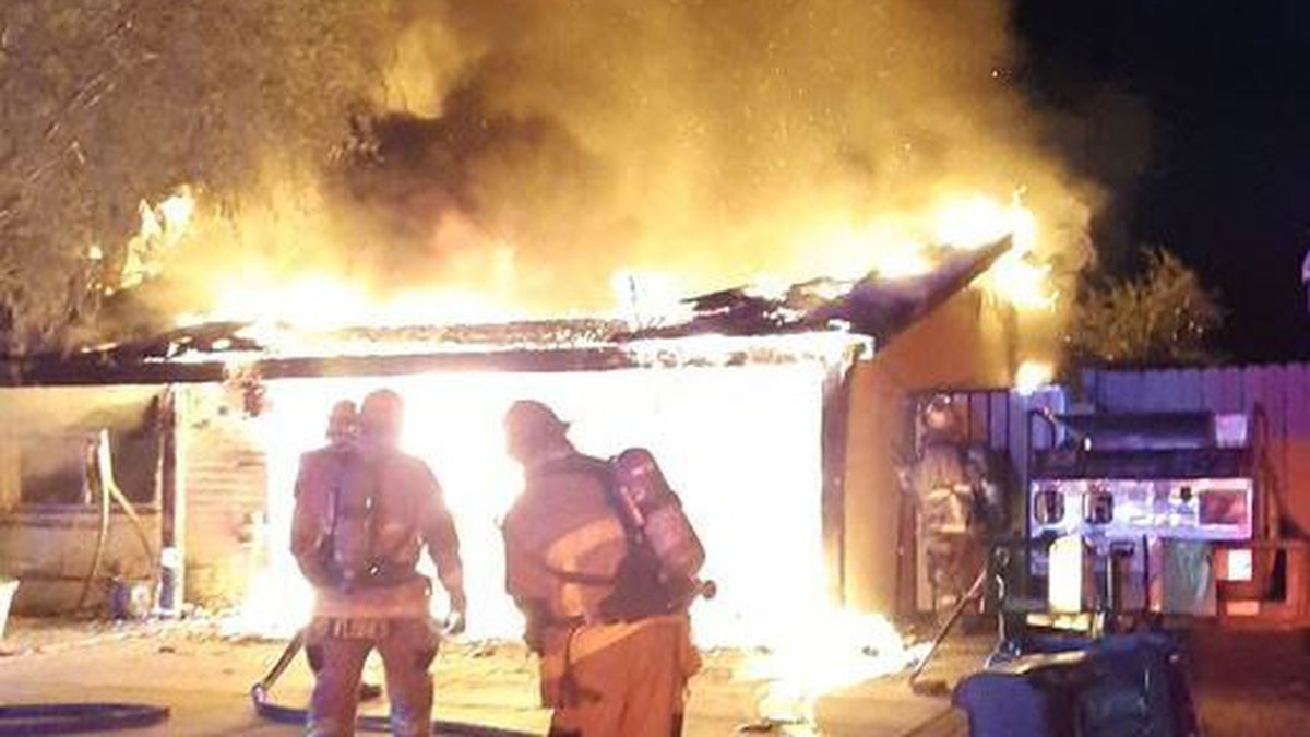 Phoenix Fire Department firefighters knocked down the blaze and kept the fire from spreading to...