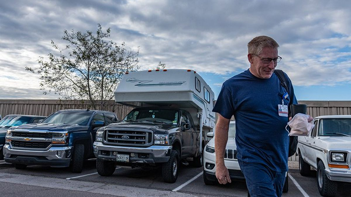 While working on the road, David Ryan showers, cooks and sleeps in his camper. He tries to...