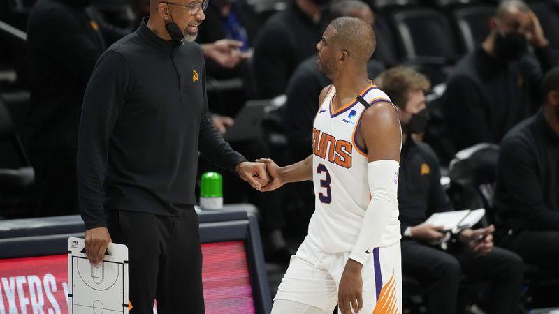 Phoenix Suns head coach Monty Williams, left, congratulates guard Chris Paul late in the second...