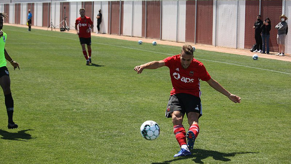 Santi Moar, who's a defender for Phoenix Rising, sends the ball into the box on a cross in...
