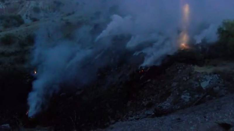 Fire fighters battled a brush fire on the east side of Tucson early Tuesday morning. (Source:...