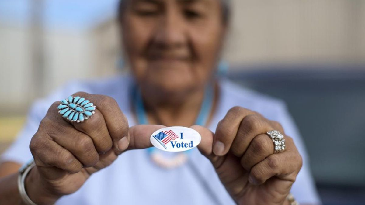 """In this Aug. 28, 2018, file photo, Mildred James of Sanders, Arizona, shows off her """"I Voted""""..."""