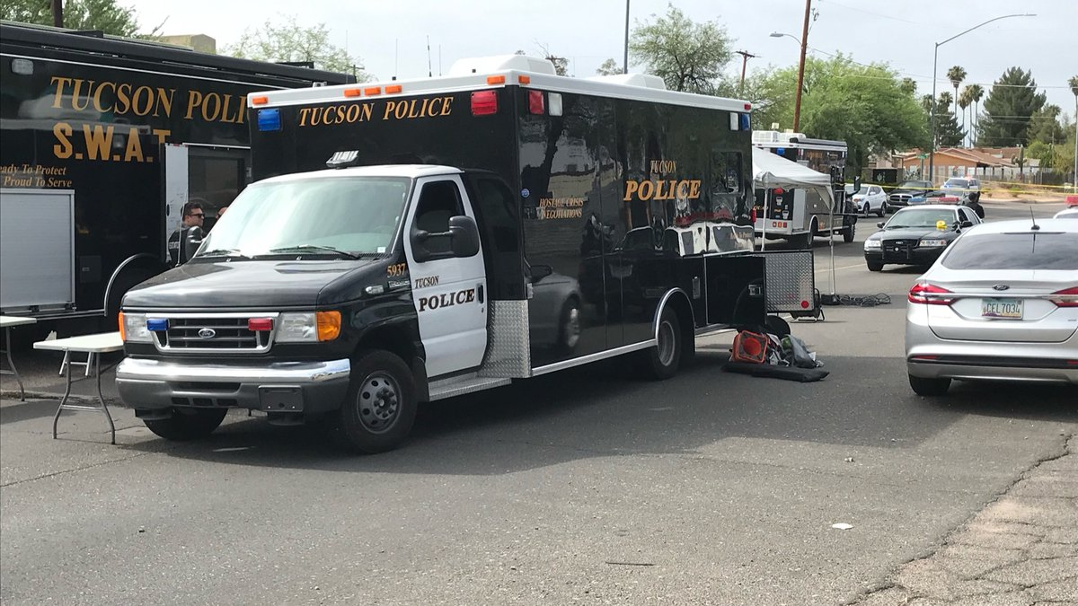 Police shut down Alvernon Way between Fort Lowell Road and Blacklidge Drive because of a...