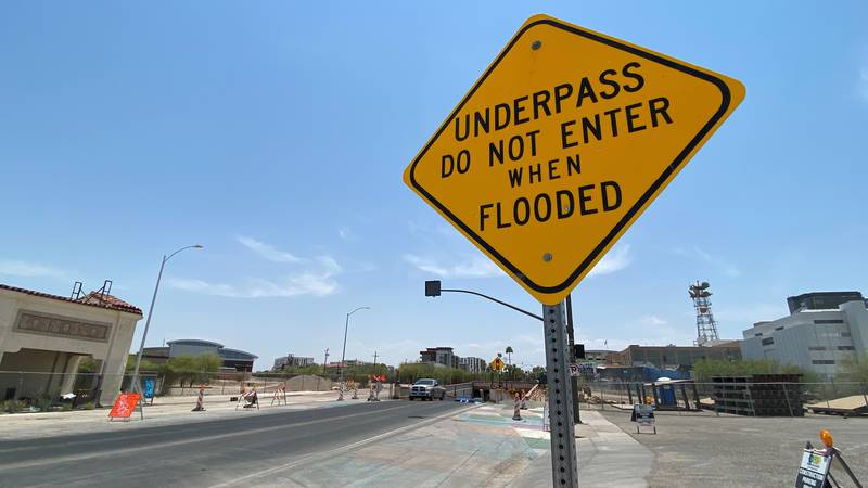 A sign warns drivers ahead of potential flooding danger. Motorists should remember to always...