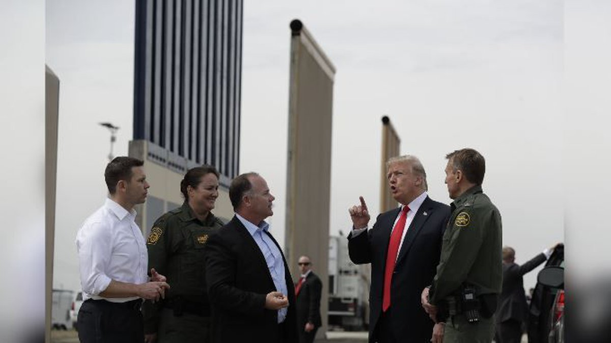 President Donald Trump reviews border wall prototypes, Tuesday, March 13, 2018, in San Diego....