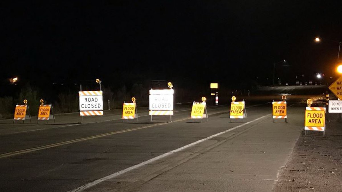 Harrison Road is closed at the Pantano Wash because of water flowing across the road on Tuesday...