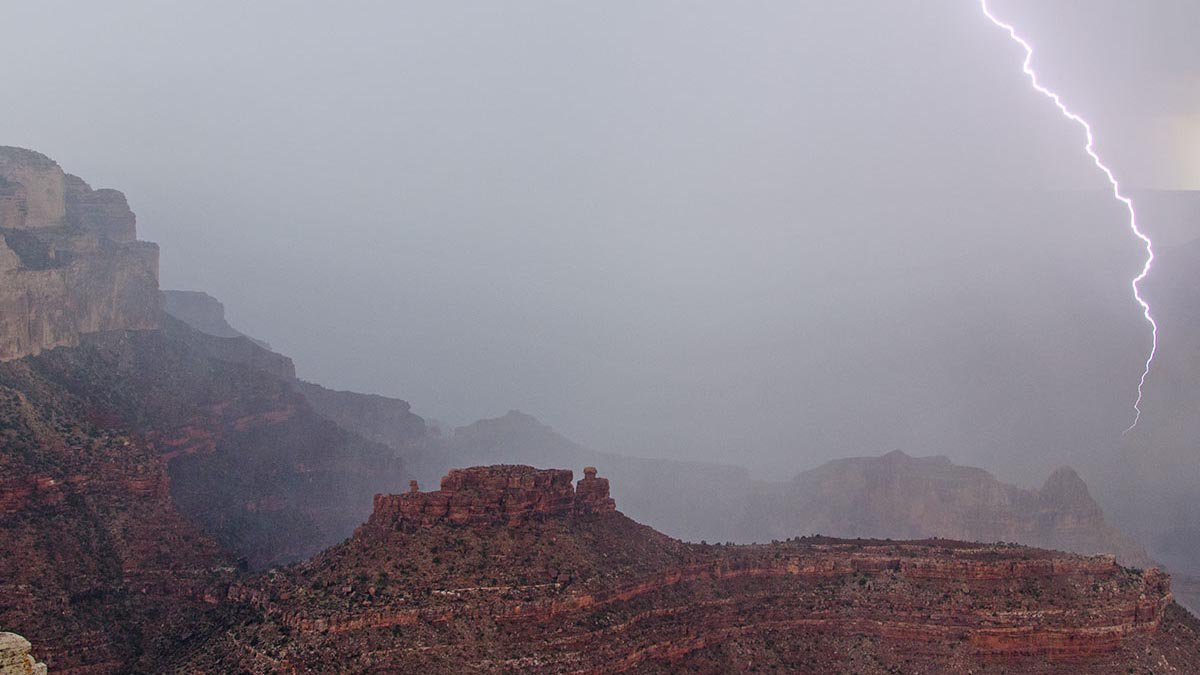 Lightning flashes the cliffs and buttes of Grand Canyon.