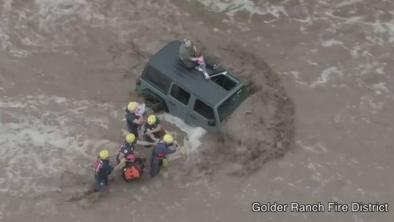 Crews from the Golder Ranch Fire District rescued a man and his two daughters from the top of...