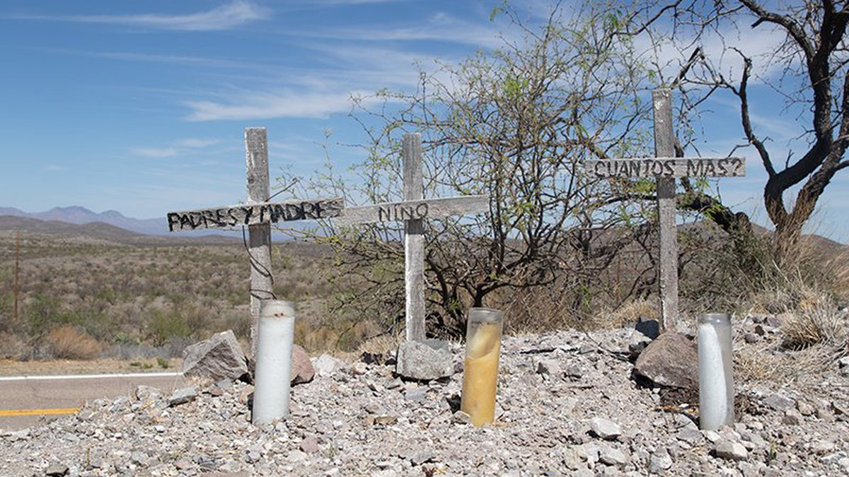 Three wooden crosses mark the locatio where the remains of a family were found near Arivaca in...