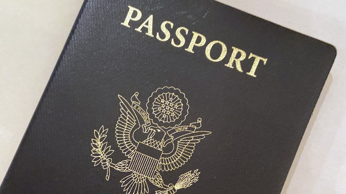 This May 25, 2021, file photo shows a U.S. Passport cover in Washington. Americans hoping to...