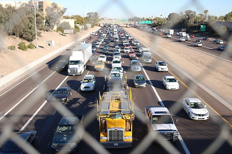 Cars and trucks pack Interstate 10 in downtown Phoenix in this 2018 photo. The COVID-19...