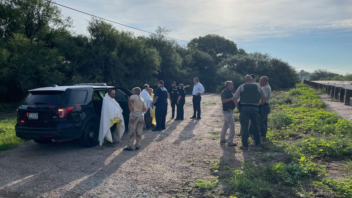 Three people were able to escape after they were washed an estimated four miles down the San...