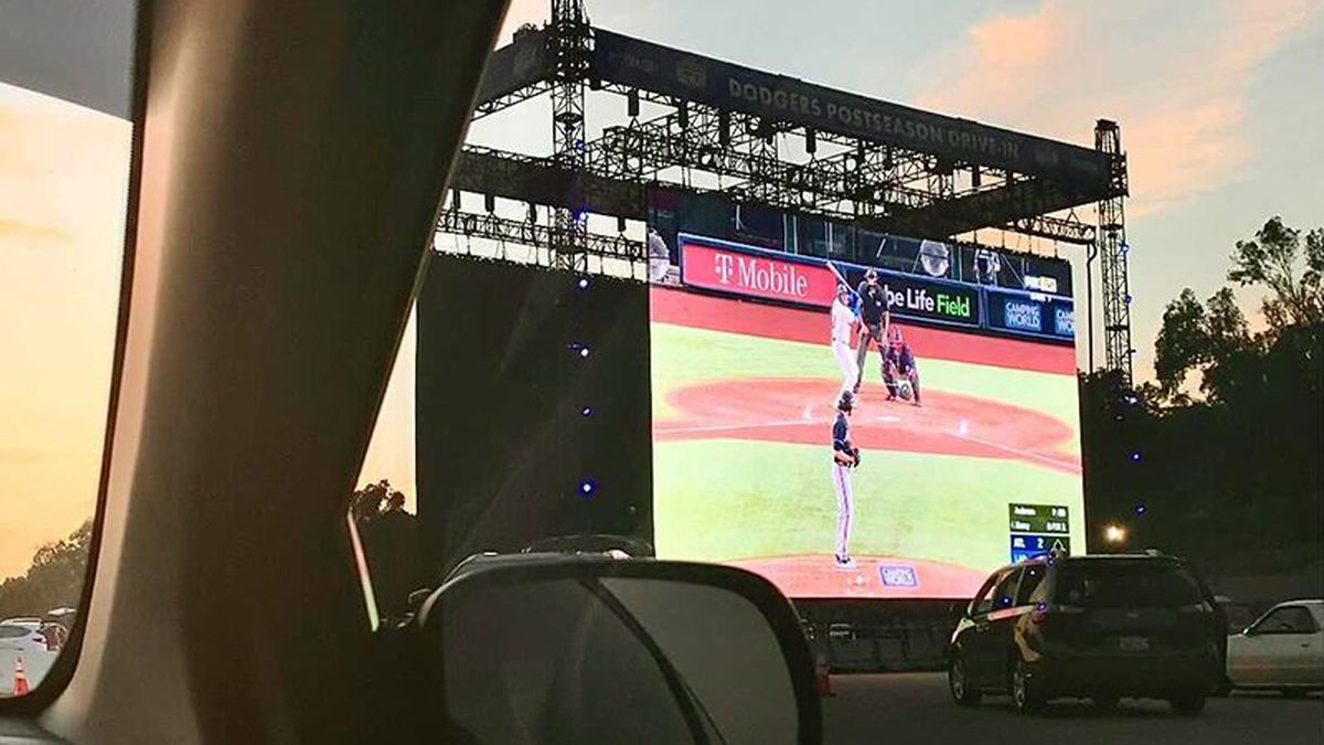 The Dodger Stadium parking lot has been transformed into a drive-in watch party for Los Angeles...
