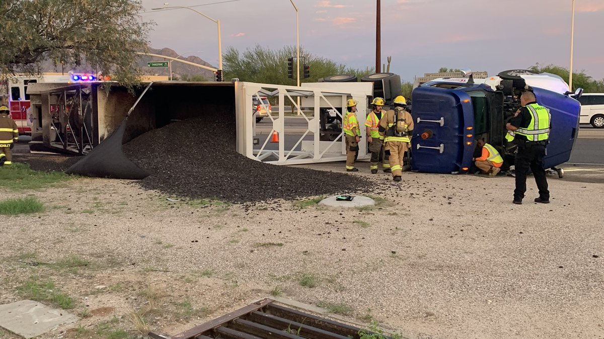 A truck overturned near the intersection of Tangerine Road and La Cañada Drive.