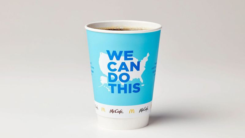 McDonald's plans to promote COVID-19 vaccines with redesigned coffee cups.